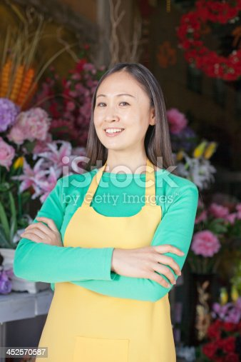 1066358064 istock photo Portrait Of Mature Woman In Flower Shop 452570587