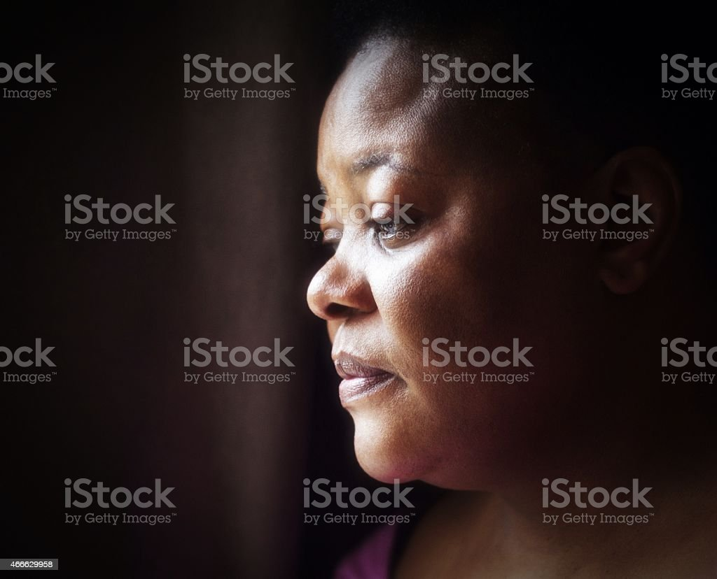 portrait of mature woman of African descent with thoughtful expression stock photo