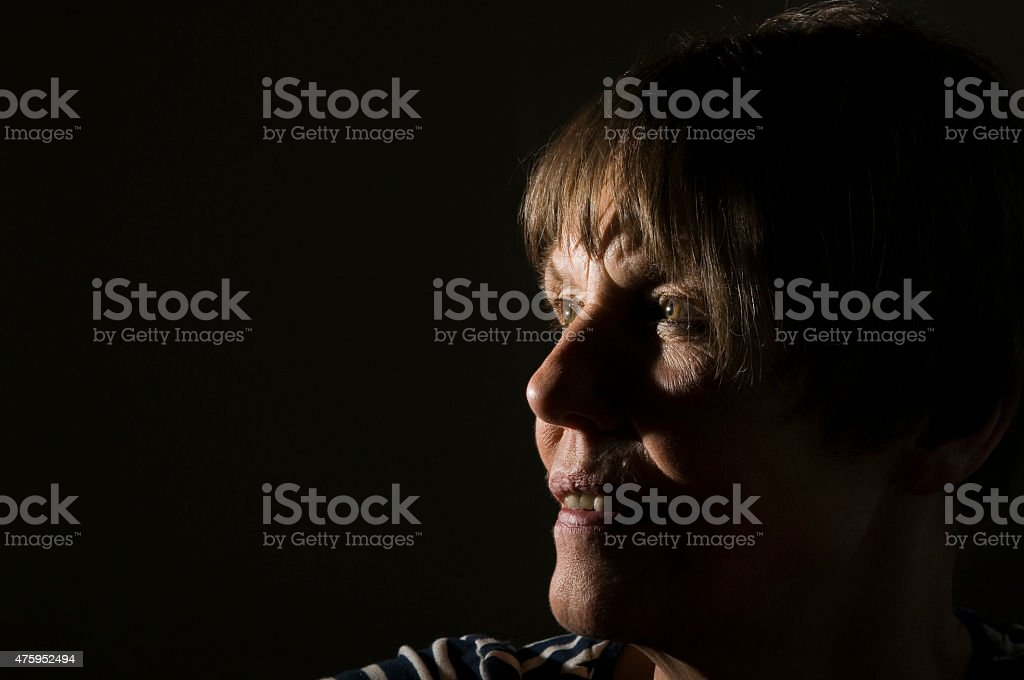 portrait of mature woman on black stock photo