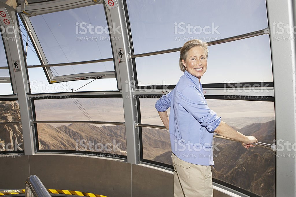 Portrait of mature woman on tram royaltyfri bildbanksbilder