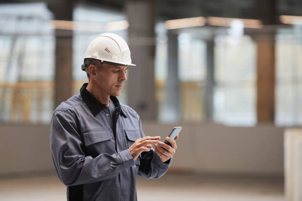 Portrait of Mature Worker Holding Smartphone stock photo