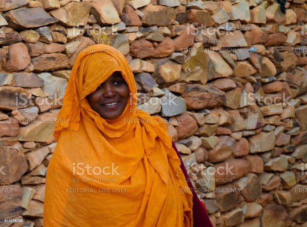 Portrait of mauritanian woman in national dress Melhfa , Chinguetti, Mauritania stock photo