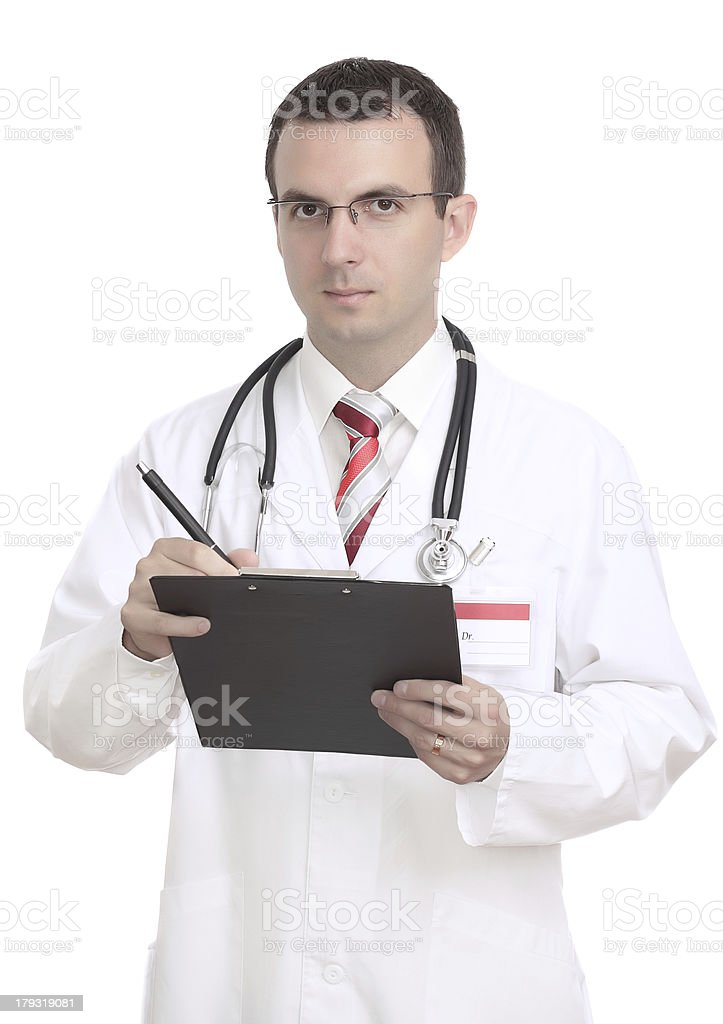 Portrait of medical doctor. Write on paper pad. royalty-free stock photo