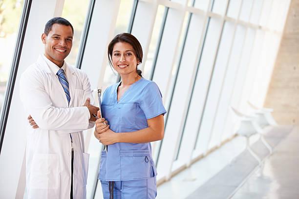 Portrait Of Medical Staff In Corridor Inside Modern Hospital stock photo