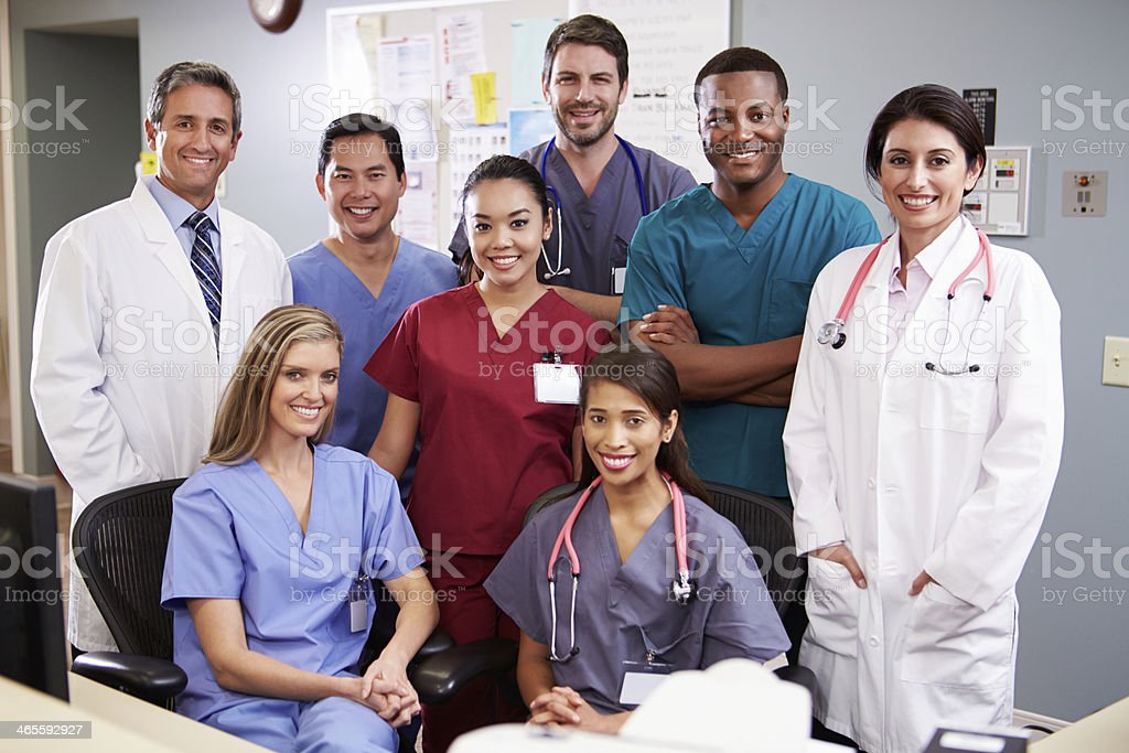 Portrait Of Medical Team At Nurses Station stock photo