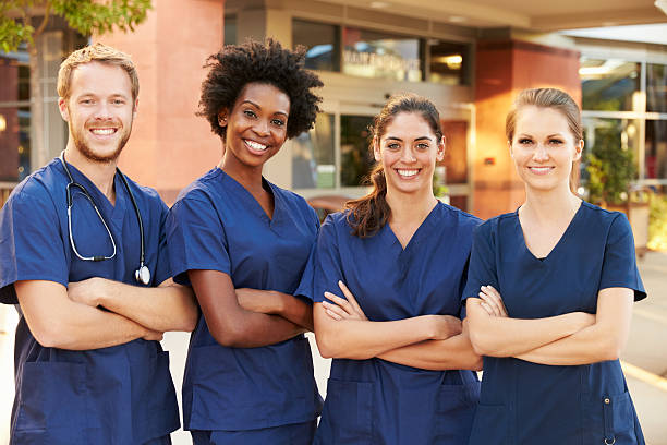 Portrait Of Medical Team Standing Outside Hospital stock photo