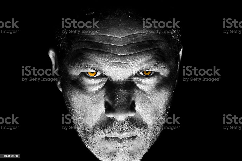 Portrait of menacing looking caucasian man stock photo