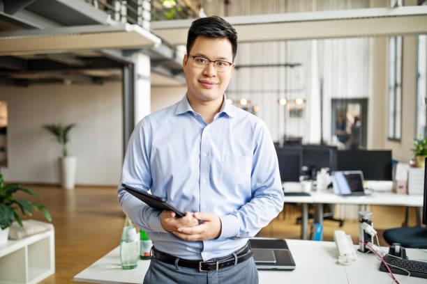 Portrait of mid adult asian businessman stock photo