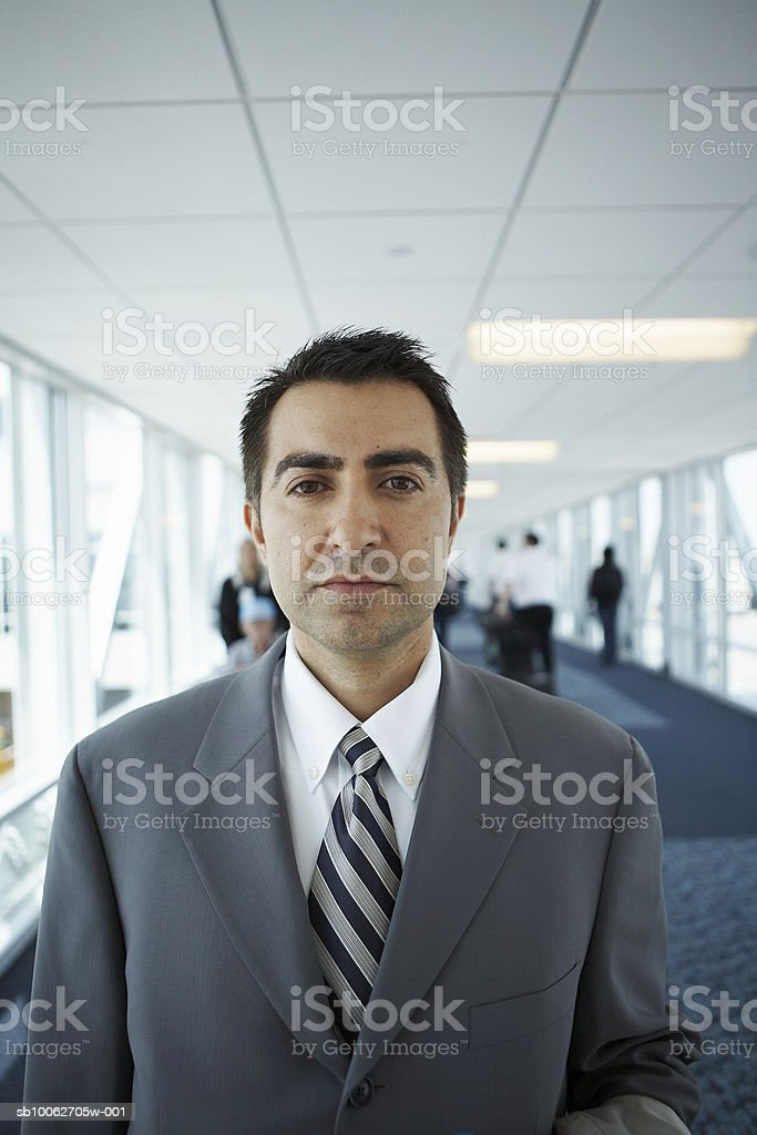 Portrait of mid adult business man in airport royalty-free stock photo