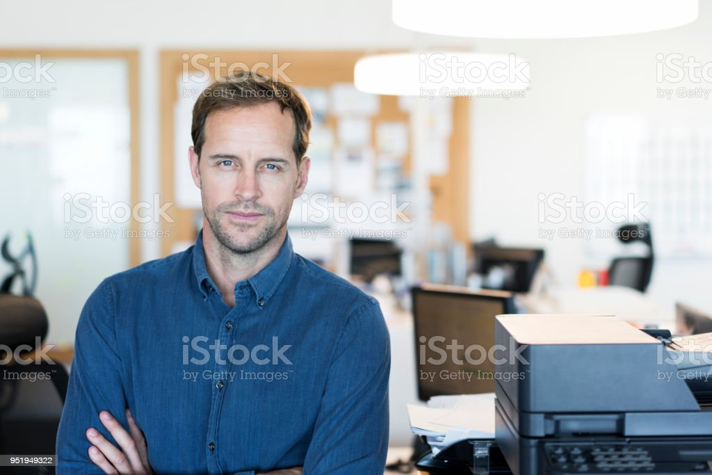 Close-up of mid adult businessman. Portrait of male professional...