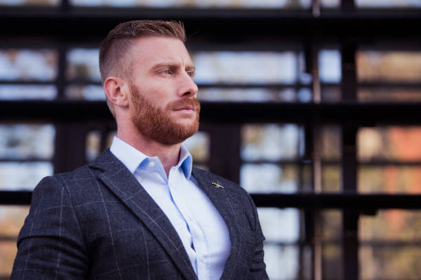 Portrait of mid adult businessman contemplating. stock photo