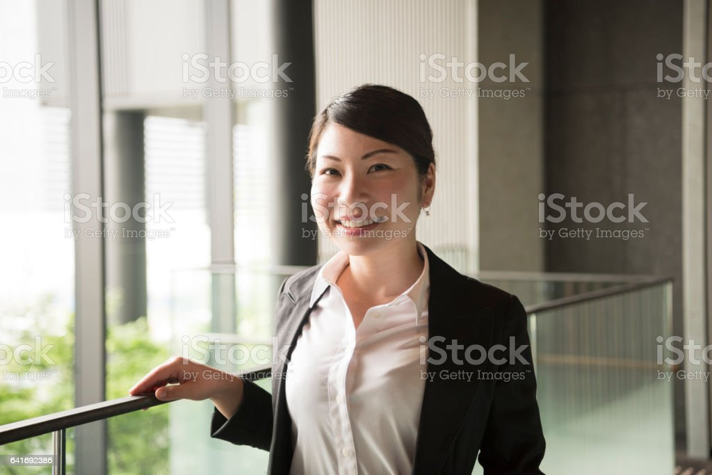 Portrait of mid adult Japanese businesswoman smiling stock photo