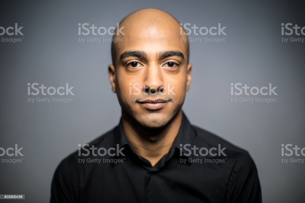 Portrait Of Mid Adult Man Against Gray Background stock photo