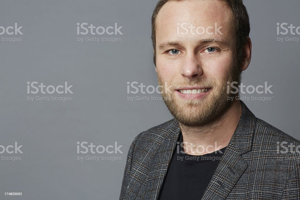 Portrait of mid adult man in grey jacket royalty-free stock photo