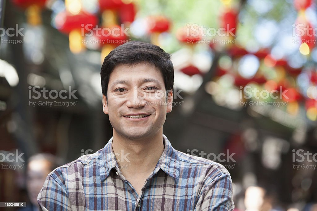 Portrait of Mid Adult Man in Nanluoguxiang, Beijing stock photo