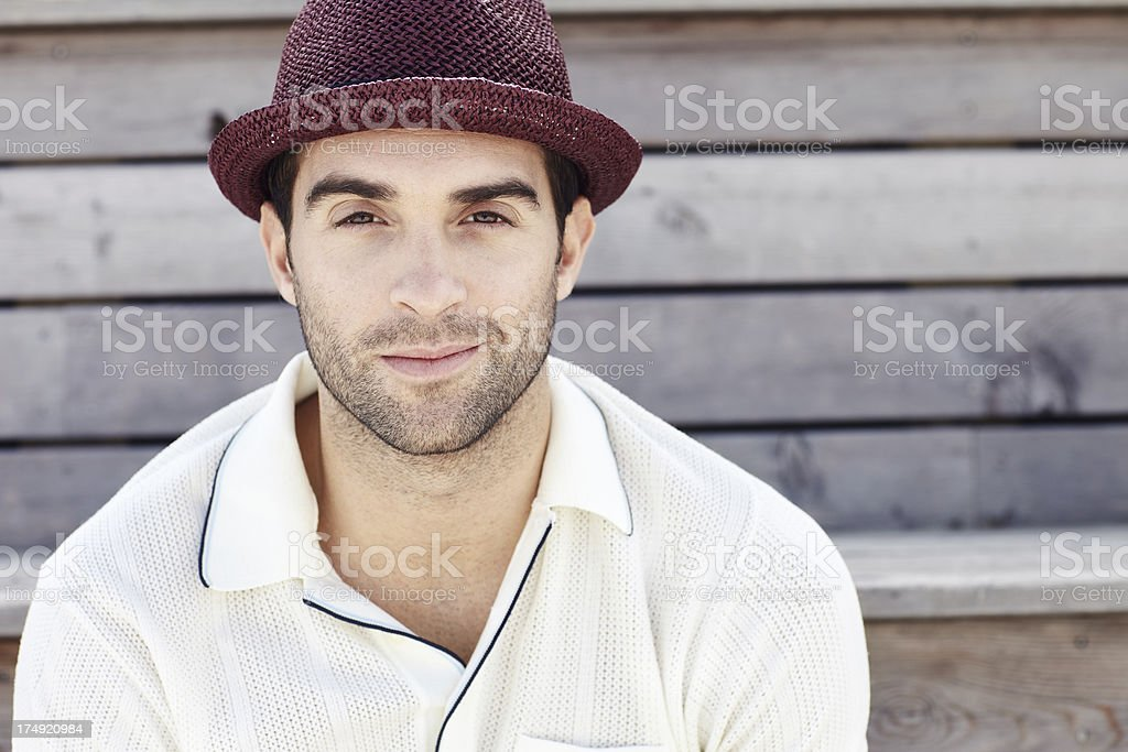 Portrait of mid adult man in red trilby, smiling stock photo