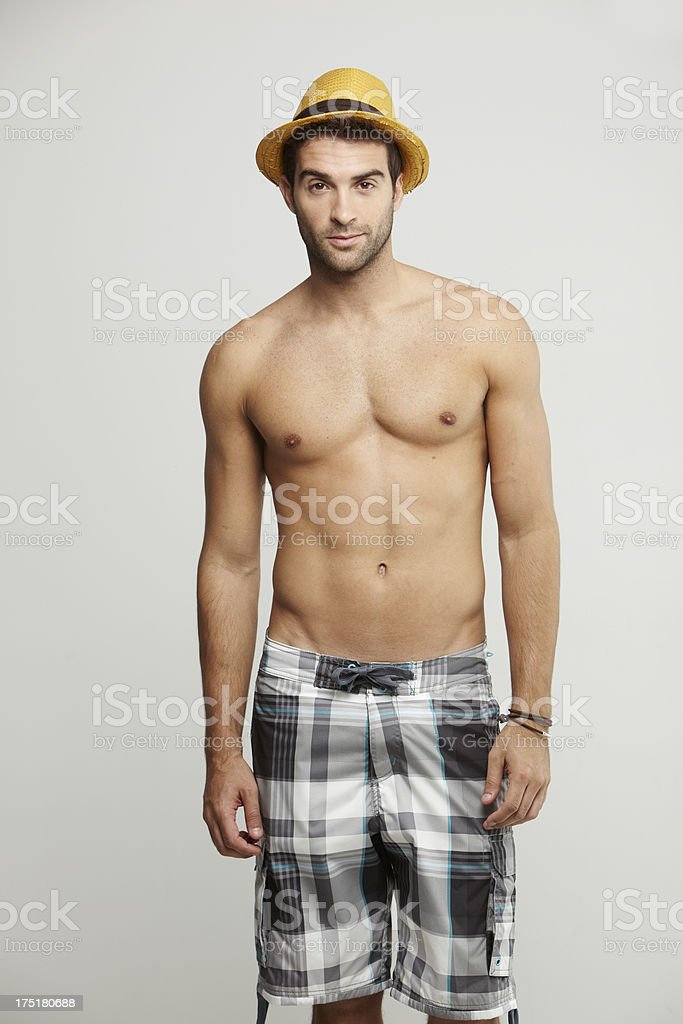 Portrait of mid adult man in shorts and hat royalty-free stock photo