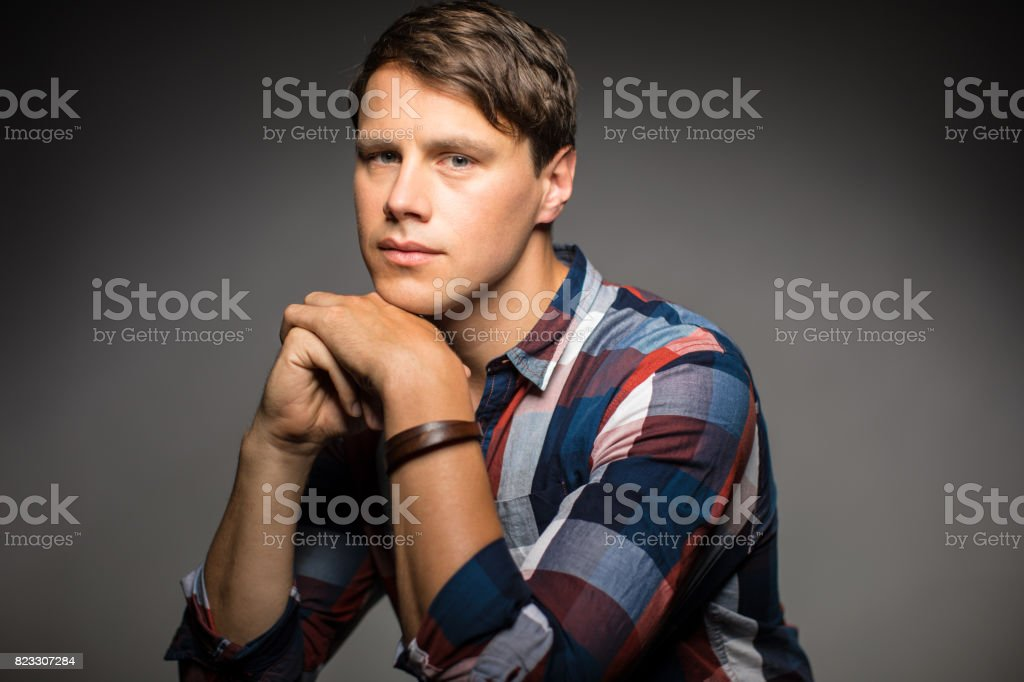 Portrait Of Mid Adult Man With Hands Clasped stock photo