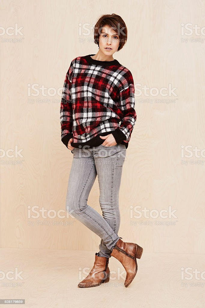 Portrait of mid adult woman in checked top stock photo
