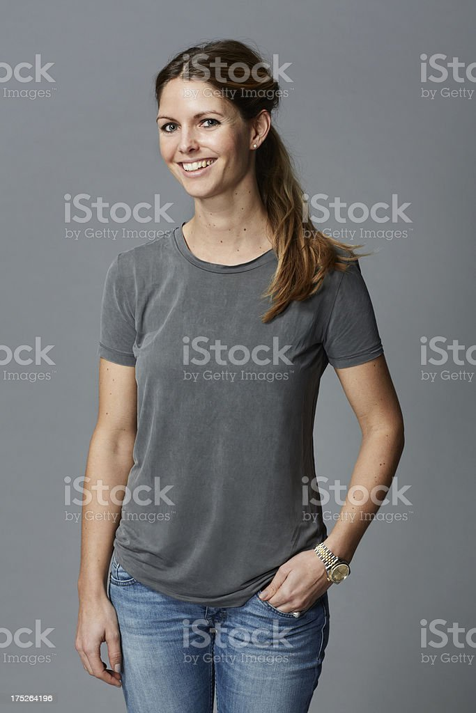 Portrait of mid adult woman in grey t-shirt royalty-free stock photo