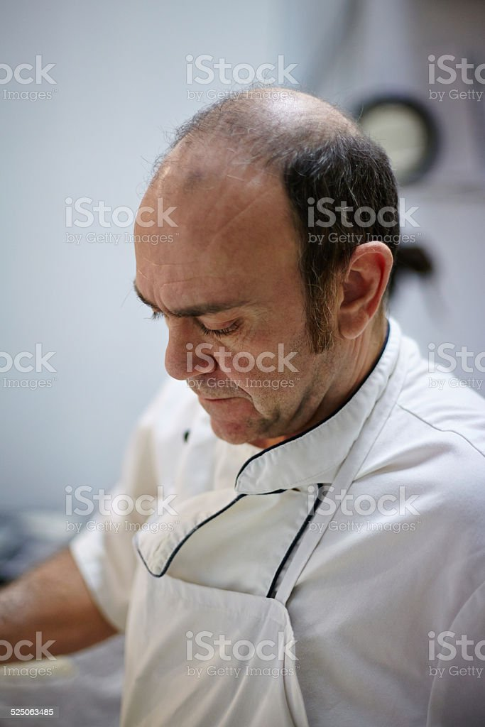 Portrait of middle age baker at work stock photo