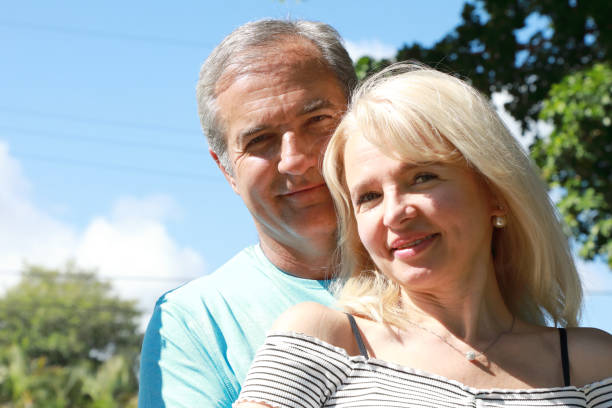 portrait of middle age married caucasian couple stock photo