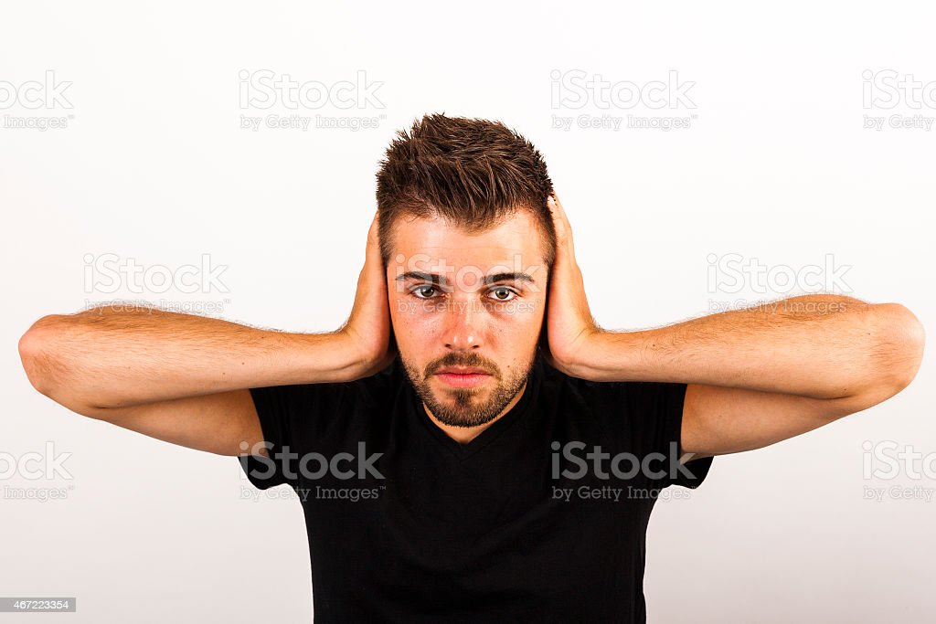 Portrait of middle aged man who cant stand the noise stock photo