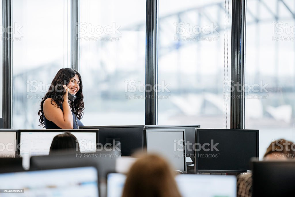 Portrait of Middle Eastern businesswoman smiling on cell phone stock photo
