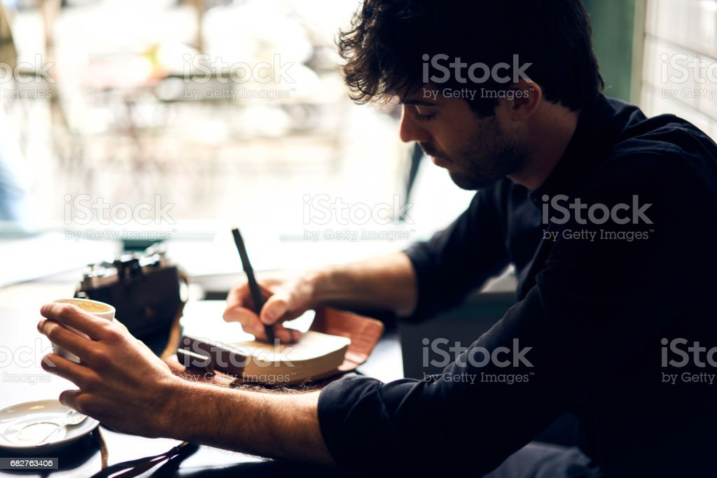 Portrait of mindful male author stock photo