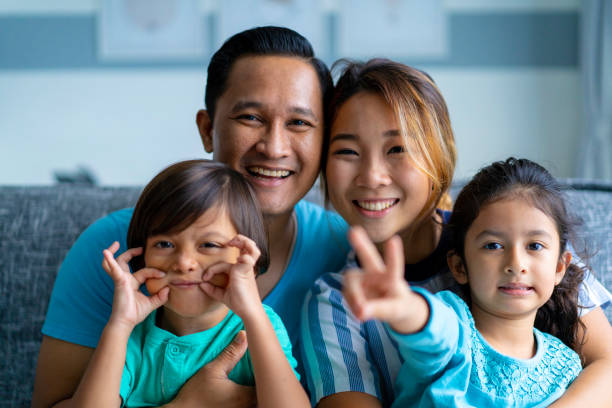 Portrait of mixed race Asian Parents with children Portrait of mixed race Asian Parents with children.  Location: Malaysia, Kuala Lumpur  iStockalypse KL indonesian ethnicity stock pictures, royalty-free photos & images