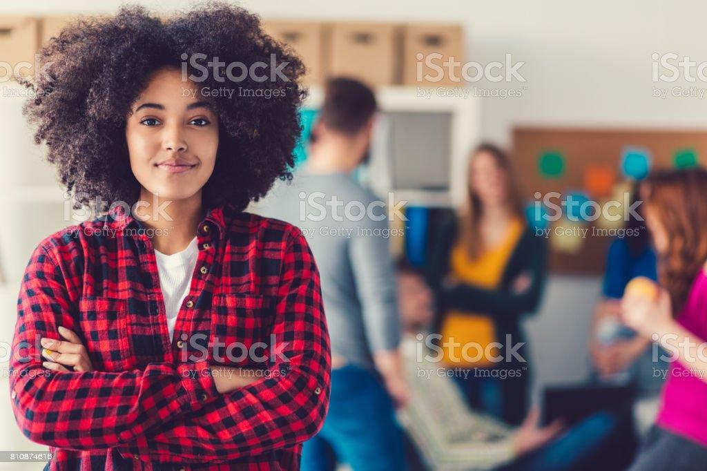 Portrait of mixed-race university student stock photo