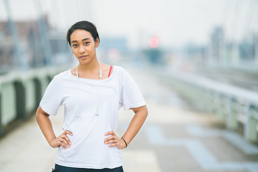 A portrait of mixed-race woman in sports clothing