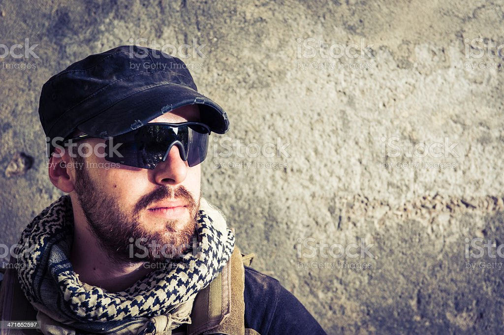 Portrait of Modern Mercenary Soldier Looking Worried to the Side royalty-free stock photo