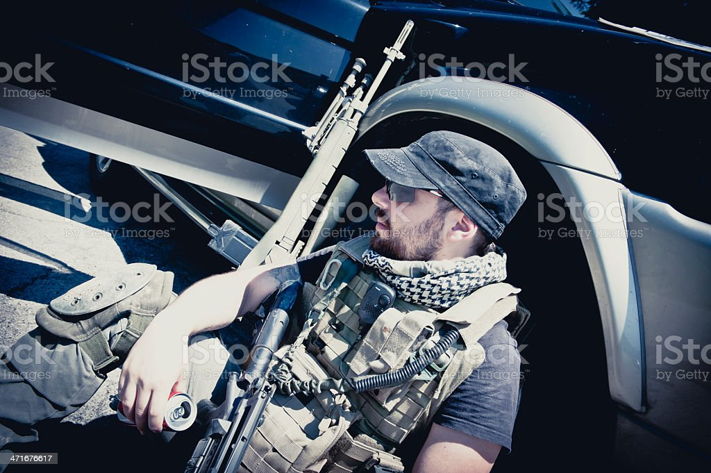 Portrait of Modern Mercenary Soldier Sitting and Waiting stock photo