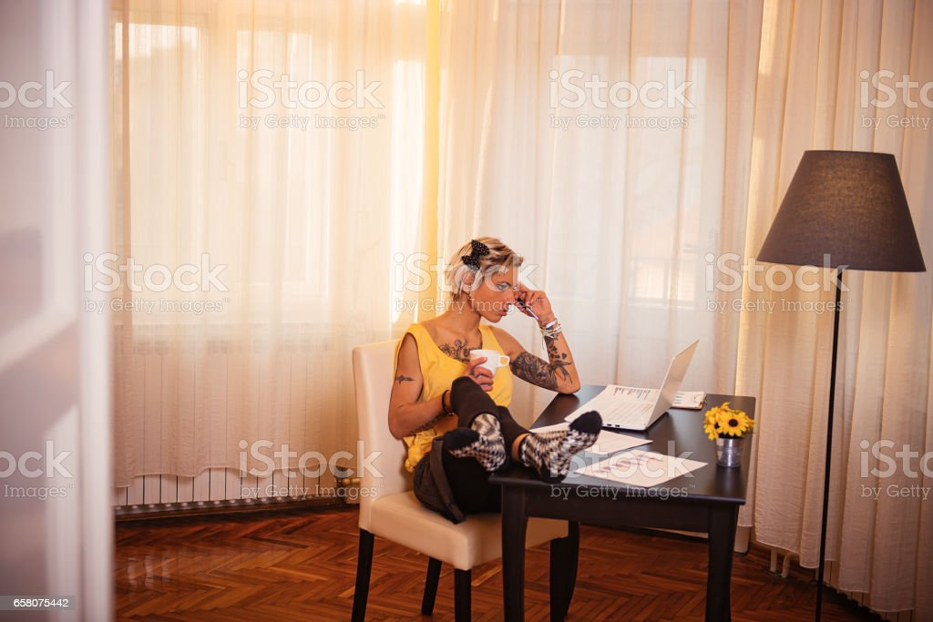 Portrait of modern woman working from home royalty-free stock photo