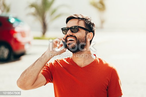 istock Portrait of modern young man talking on the phone in the street 1019547506