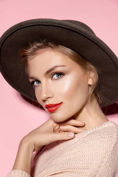 Portrait of modern young woman in  hat stock photo