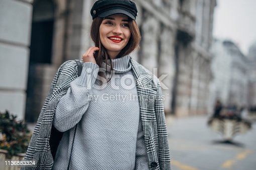 518885222istockphoto Portrait of modern young woman 1136883324