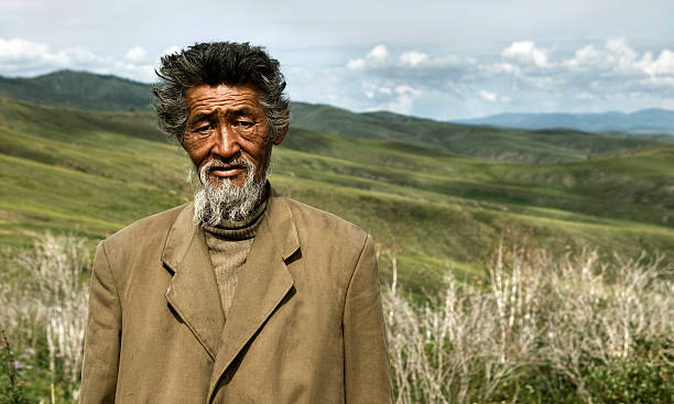 porträt von mongolische mann im feld - rawpixel stock-fotos und bilder