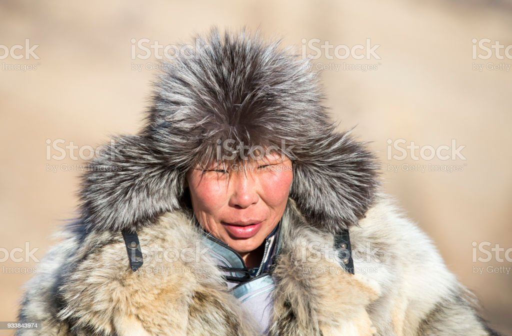 portrait of mongolian man in wolf skin clothing stock photo