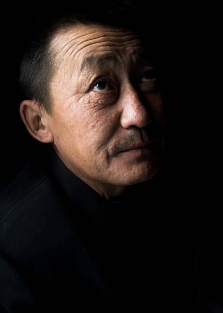 porträt von mongolische mann, low key - rawpixel stock-fotos und bilder