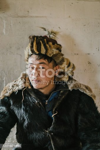 Portrait of Mongolian man in traditional clothes