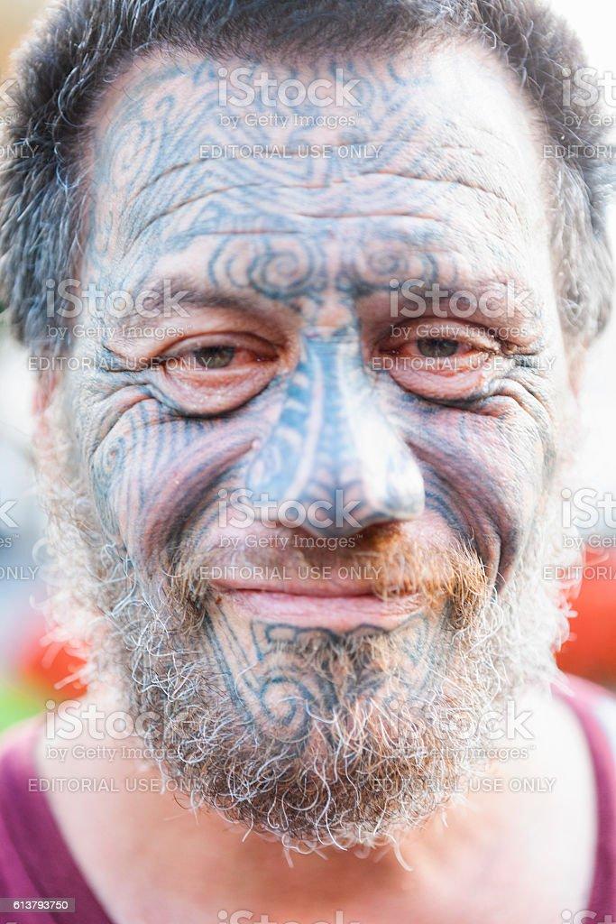 Portrait of Māori man with traditional Tā moko face tattoos stock photo