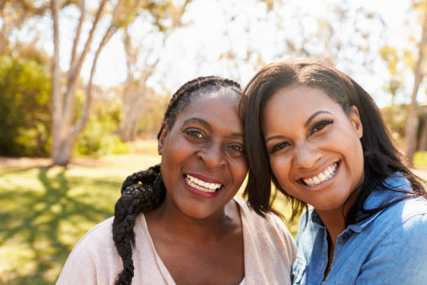 Portrait Of Mother And Adult Daughter In Park Together stock photo
