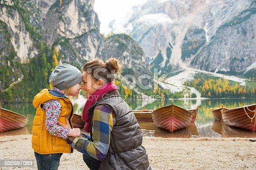 istock Portrait of mother and baby on lake braies, italy 535987089