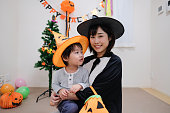 Japanese family enjoying Halloween costume and party