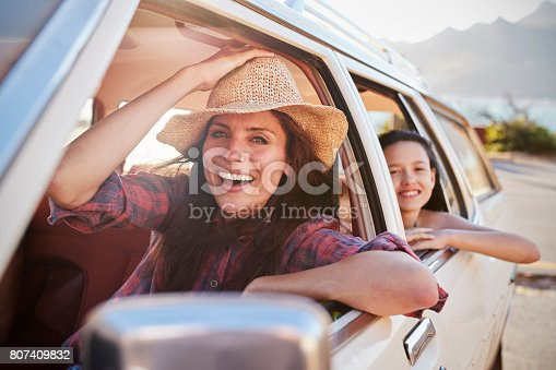 807410158 istock photo Portrait Of Mother And Children Relaxing In Car During Road Trip 807409832