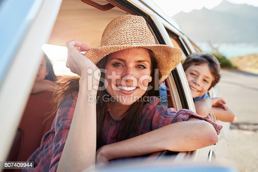 807410158 istock photo Portrait Of Mother And Children Relaxing In Car During Road Trip 807409944