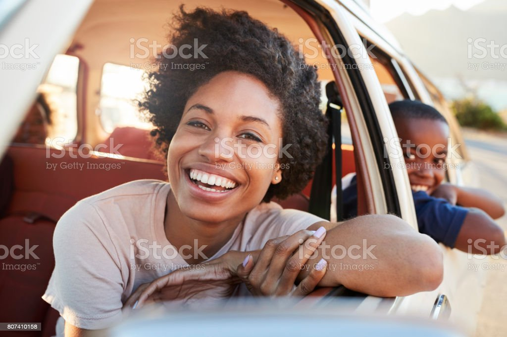 Portrait Of Mother And Children Relaxing In Car During Road Trip stock photo