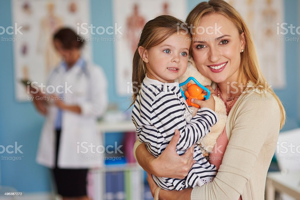 Portrait of mother and daughter at the doctor stock photo